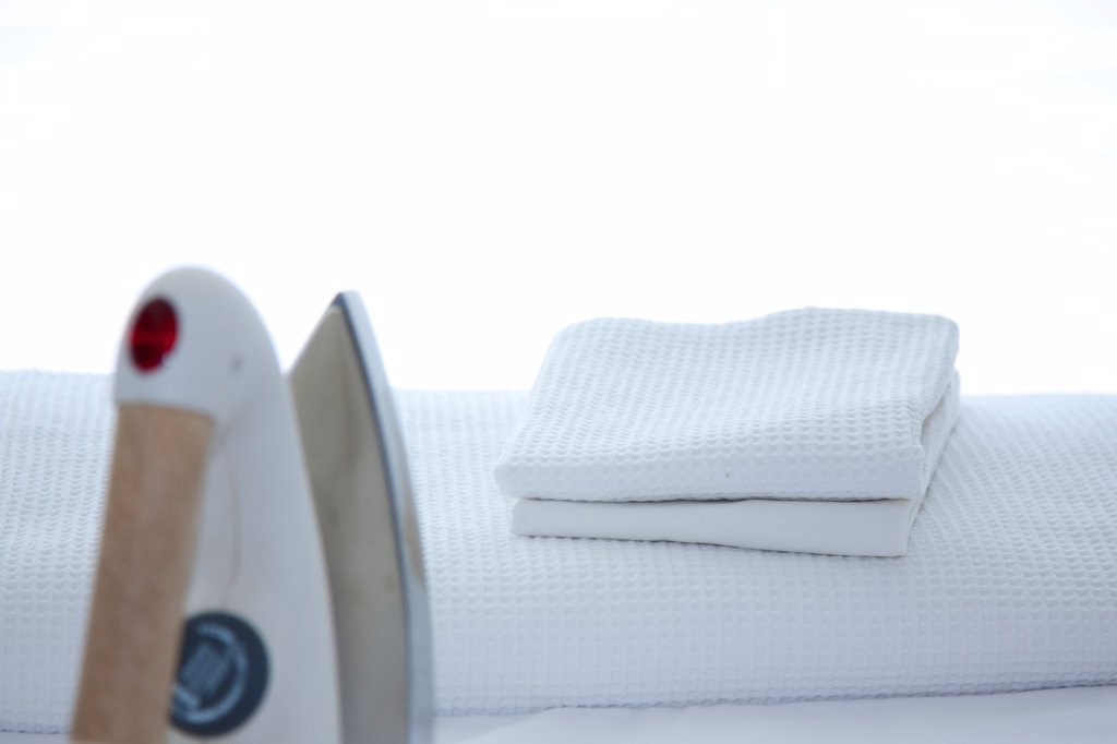 Stock Photo: 4278-9940 Folded Laundry and Iron