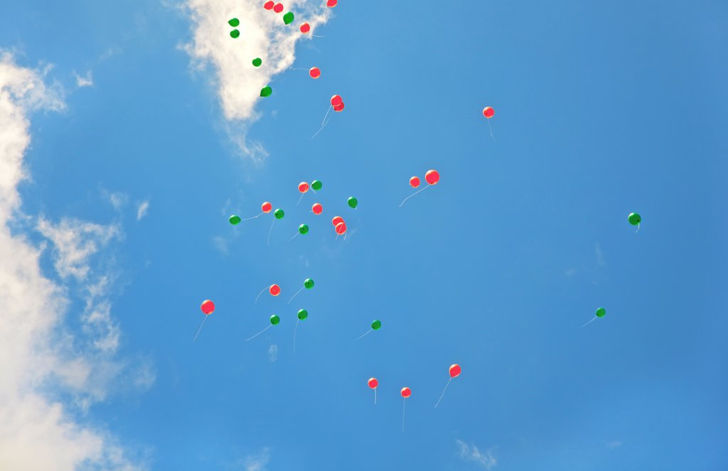 Stock Photo: 4278-9946 Balloons Flying in a Cloudy Blue Sky