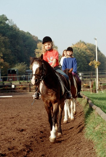 Stock Photo: 4279-1430 horse riding lesson