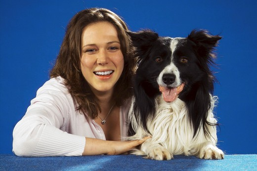 young woman next to Border Collie : Stock Photo