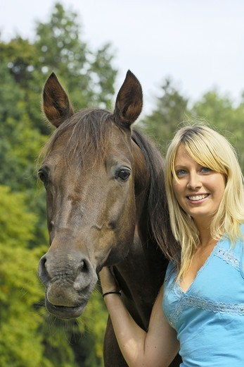 Stock Photo: 4279-24636 Young lady and her trotter horse
