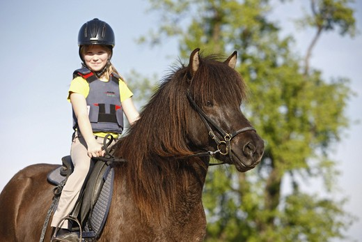 girl riding on Icelandic horse : Stock Photo