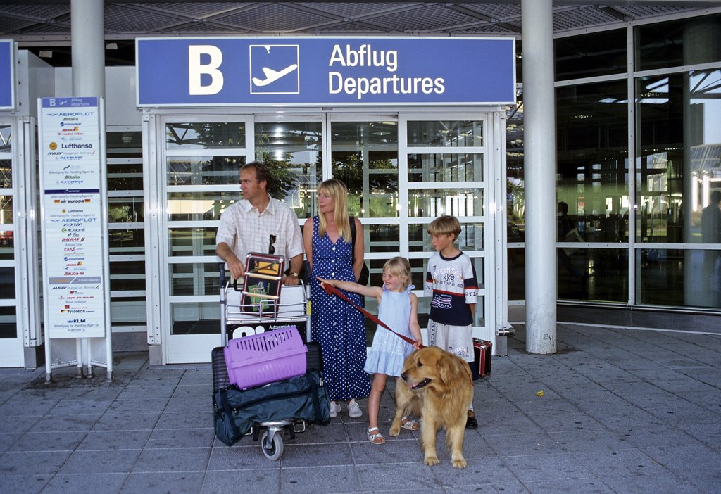 family with dog and cat at the airport : Stock Photo