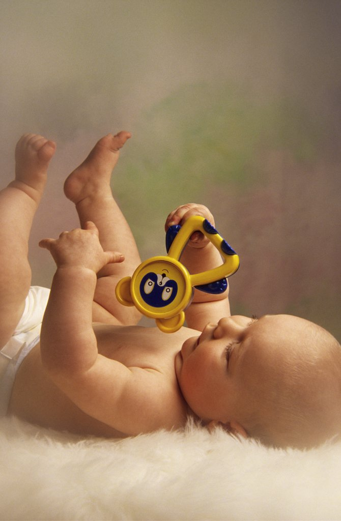 Stock Photo: 4279R-48435 baby with toy