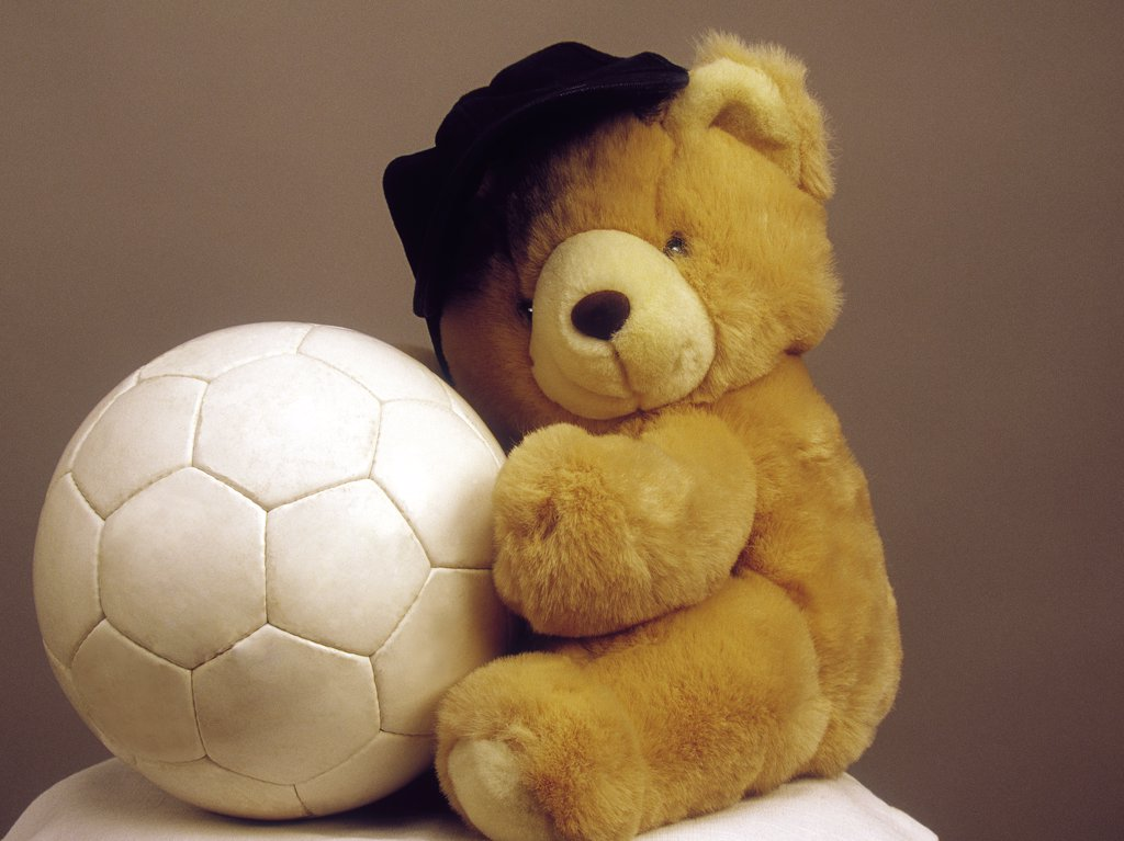 Teddy with ball : Stock Photo