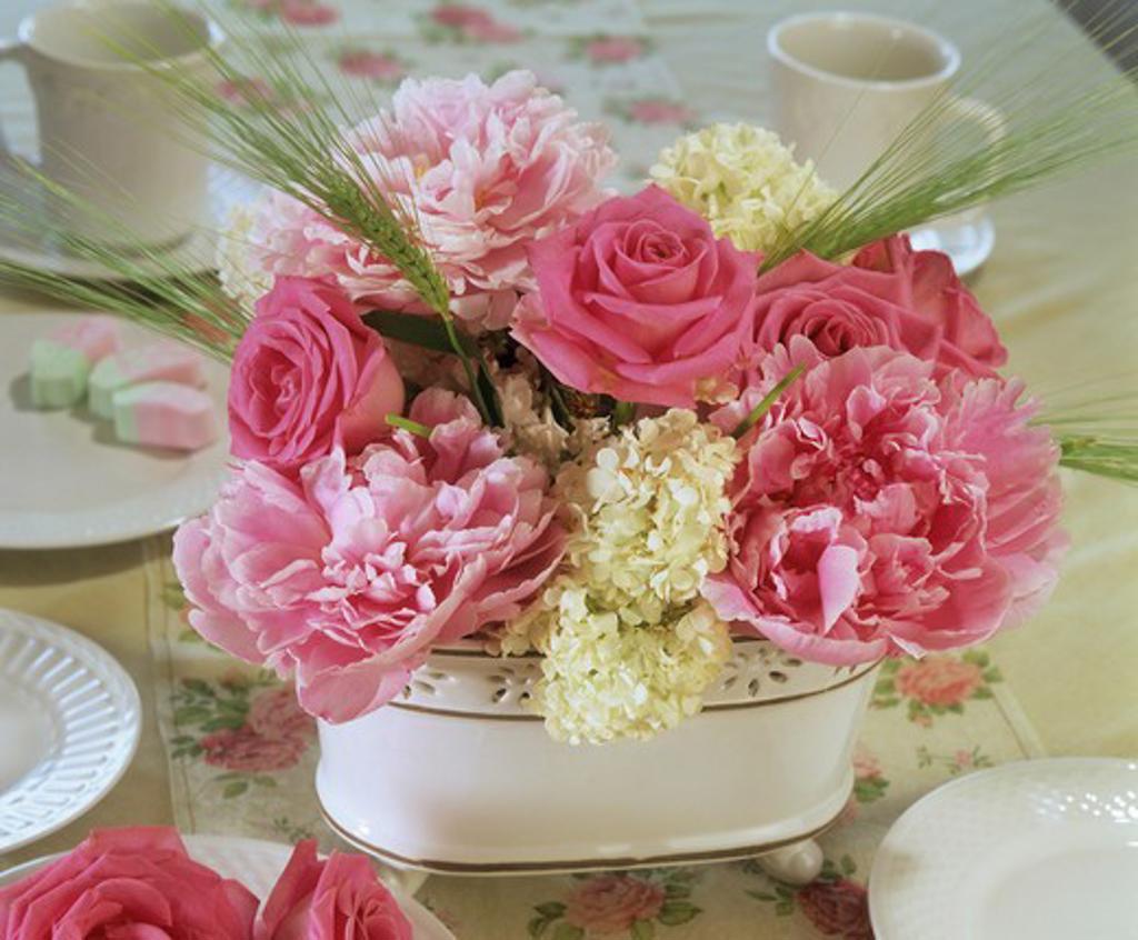 flower arrangement , roses, peonies and viburnum : Stock Photo
