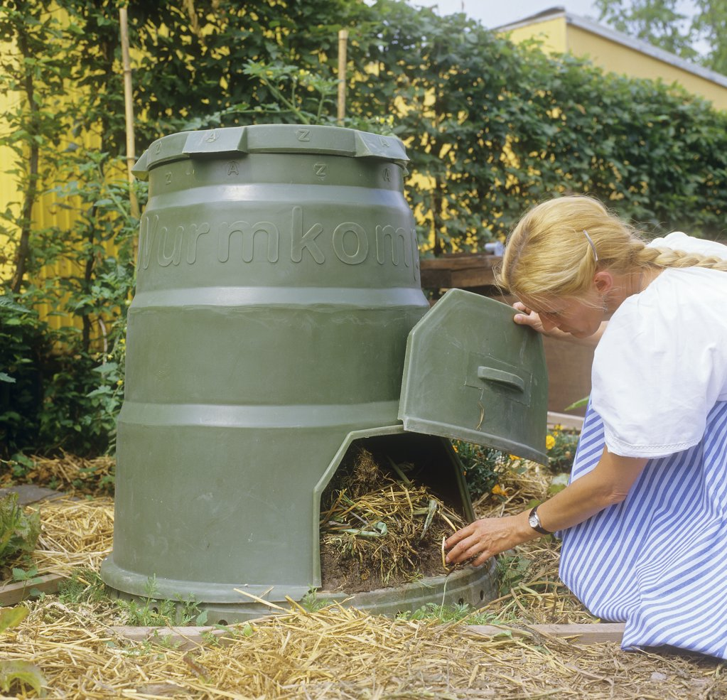 woman at compost : Stock Photo