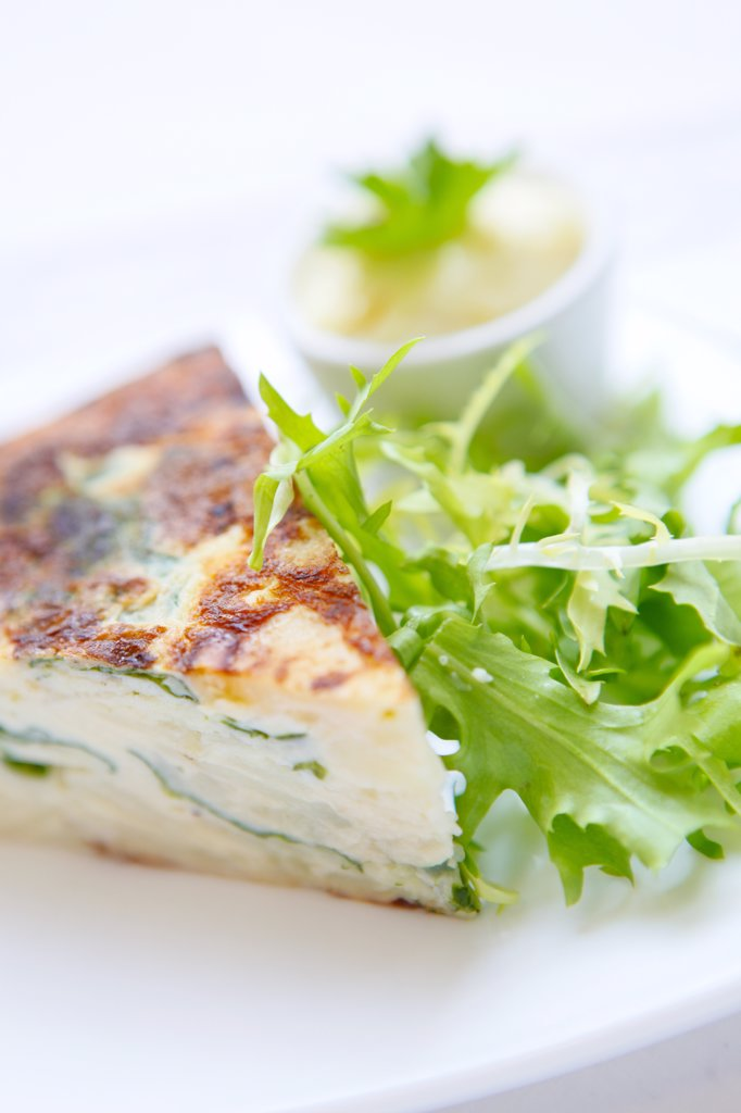 Stock Photo: 4282-10436 England, West Midlands, Birmingham. A slice of Quiche with salad.