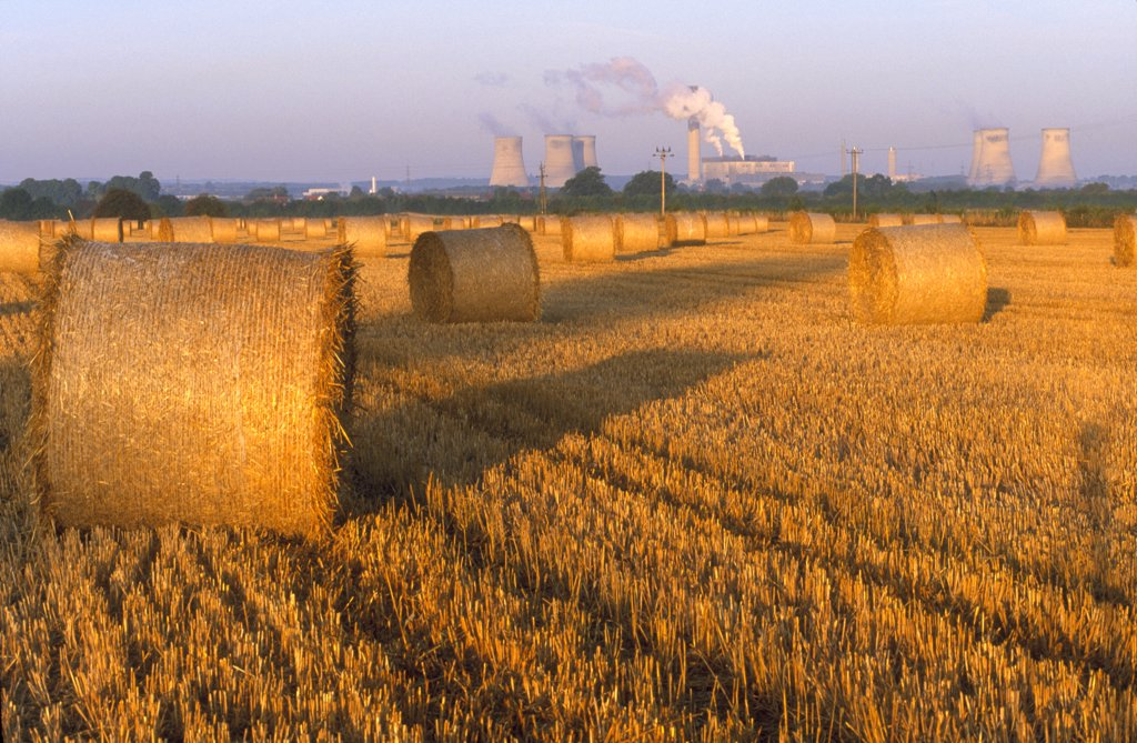 Stock Photo: 4282-10882 England, Oxfordshire, Didcot. Didcot Power Station and cornfield that has just been harvested.