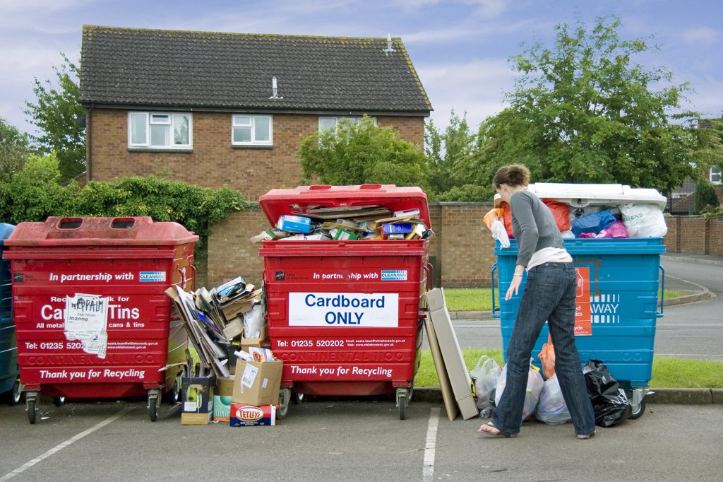 Stock Photo: 4282-11236 England, Oxfordshire, Abingdon. An overflowing waste recycling point on an Oxfordshire housing estate.