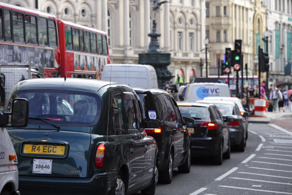 England, London, Piccadilly. Traffic congestion on the road at Piccadilly Circus. : Stock Photo