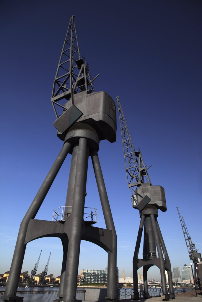 England, London, Royal Victoria Dock. Derelict cranes stand as a reminder of the past at Royal Victoria Dock in the redeveloped Docklands area of London. : Stock Photo