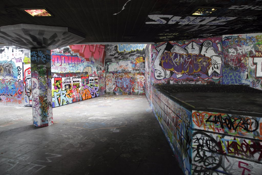 England, London, South Bank. Graffiti covering the walls of the under-croft on the South Bank in London. : Stock Photo