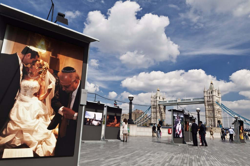 Stock Photo: 4282-11993 England, London, Tower Bridge. A photographic exhibition on the South Bank by Tower Bridge.