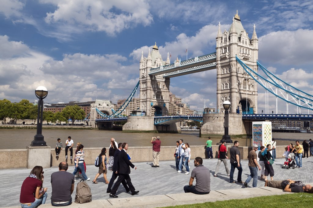 Stock Photo: 4282-11994 England, London, Tower Bridge. People walking along the Thames path on the South Bank by Tower Bridge.