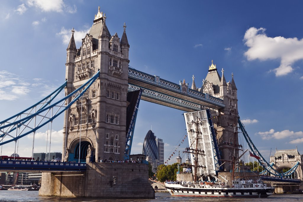 Stock Photo: 4282-11997 England, London, Tower Bridge. The bascules of Tower Bridge are raised to allow a tall ship to travel along the River Thames.
