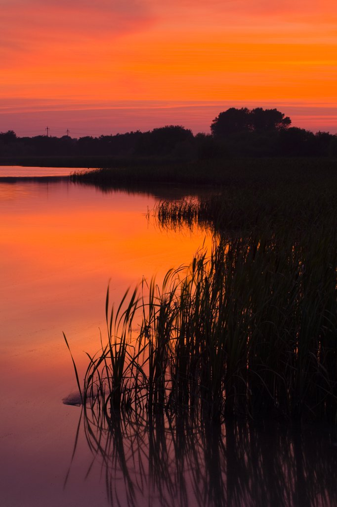 Stock Photo: 4282-12449 England, Tyne and Wear, Big Waters Country Park. Sunset over the lake in Big Waters Country Park. The lake is a a subsidence pond, formed by the collapse of old mine workings.