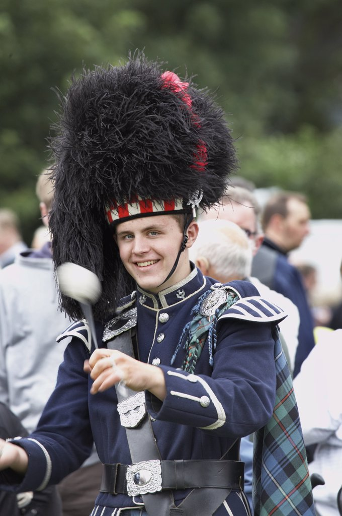 Stock Photo: 4282-13609 Scotland, Aberdeenshire, Strathdon. A drummer from a pipe band marching at the Lonach Gathering and Highland Games, (billed as 'Äö?Ñ??Scotland's friendliest Highland Games'Äö?Ñ?¥) held annually in August.