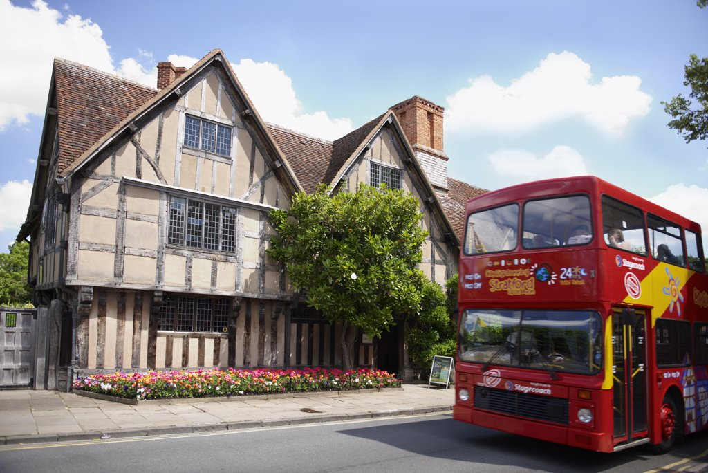 Stock Photo: 4282-1376 England, Warwickshire, Stratford-upon-Avon. A sightseeing tour bus outside Hall's Croft, once the home of Shakespeare's daughter Susanna.