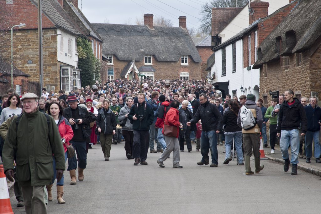 Stock Photo: 4282-13999 England, Leicestershire, Hallaton. Crowds parade through the village of Hallaton for the traditional Easter Monday Bottle-kicking event.