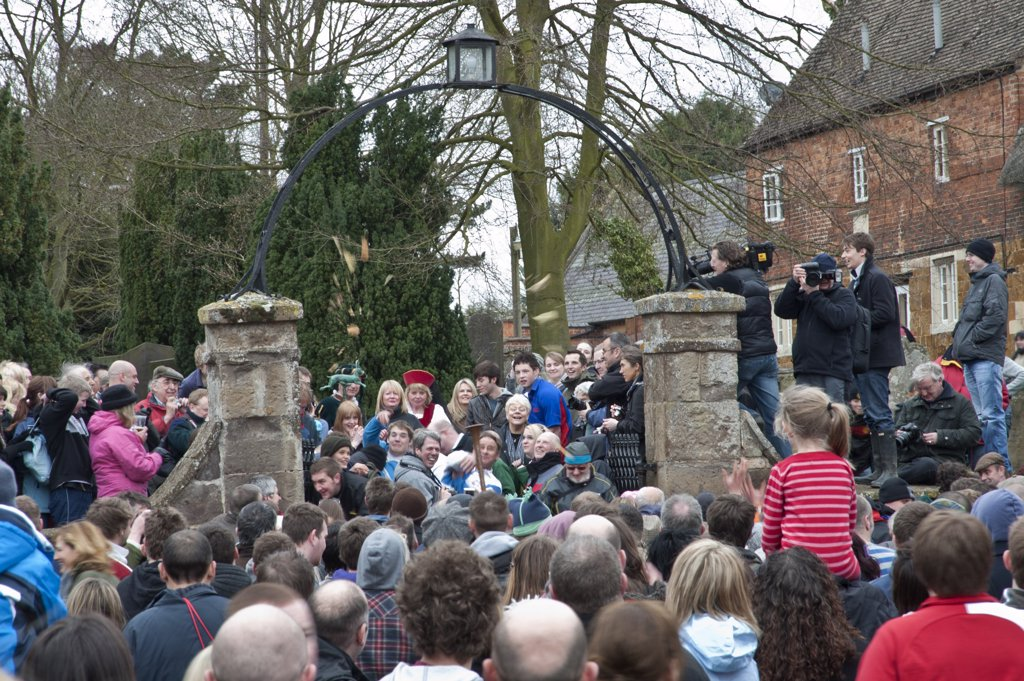 Stock Photo: 4282-14001 England, Leicestershire, Hallaton. A hare pie is thrown to the crowd for the traditional scramble on Easter Monday.