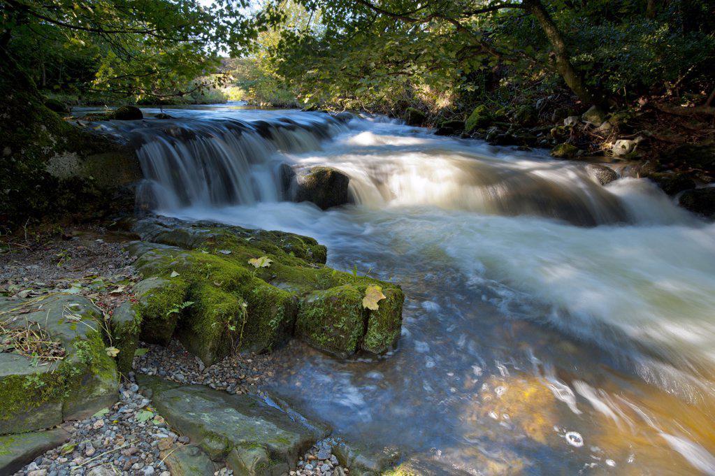 Stock Photo: 4282-14002 England, Cumbria, Caldbeck. The River Caldew flowing over rocks through Caldbeck.