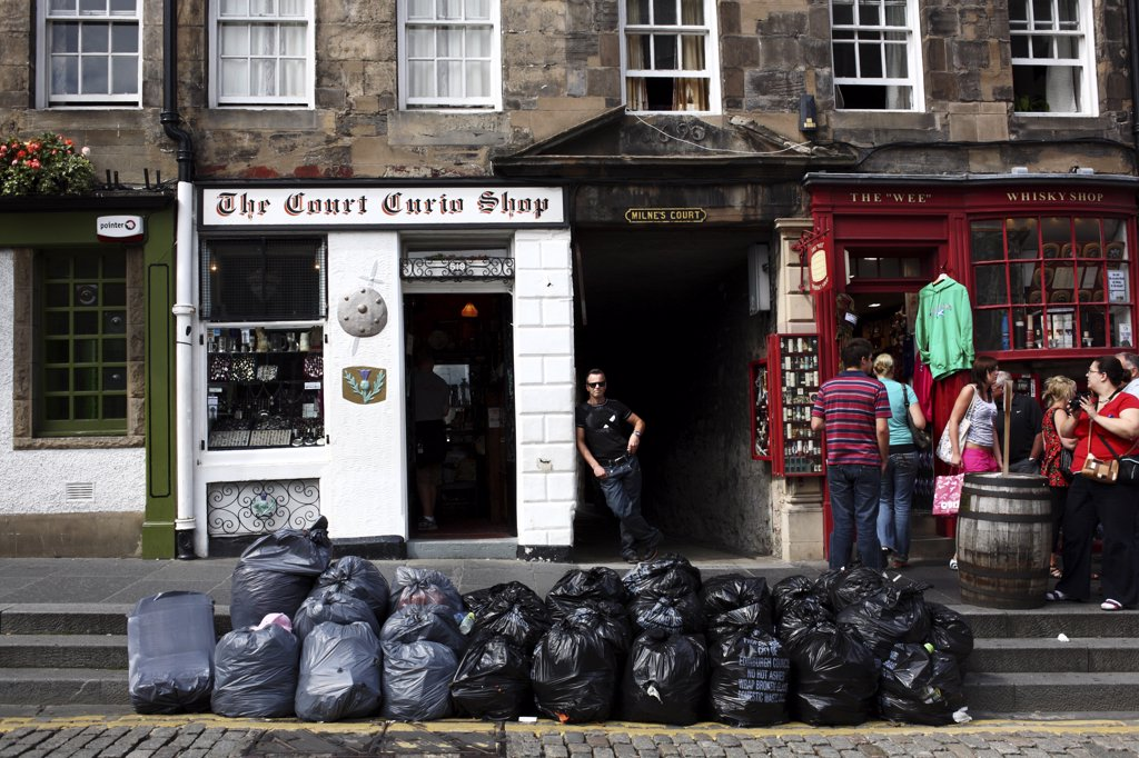 Stock Photo: 4282-14215 Scotland, City of Edinburgh, Edinburgh. Rubbish bags mounting up in the Royal Mile due to a strike.