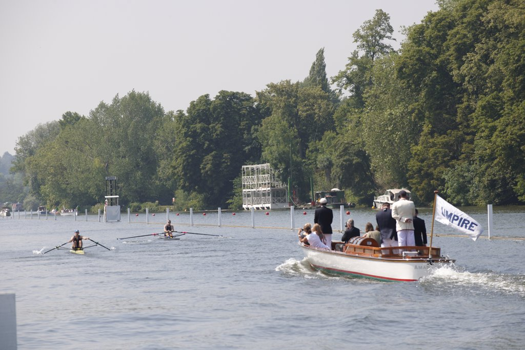 Stock Photo: 4282-1443 England, Oxfordshire, Henley-on-Thames. The umpire's boat following a race up the course at the annual Henley Royal Regatta.