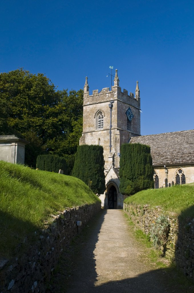 Stock Photo: 4282-14432 England, Gloucestershire, Upper Slaughter. Path leading to the Norman church of St Peters in the village of Upper Slaughter.