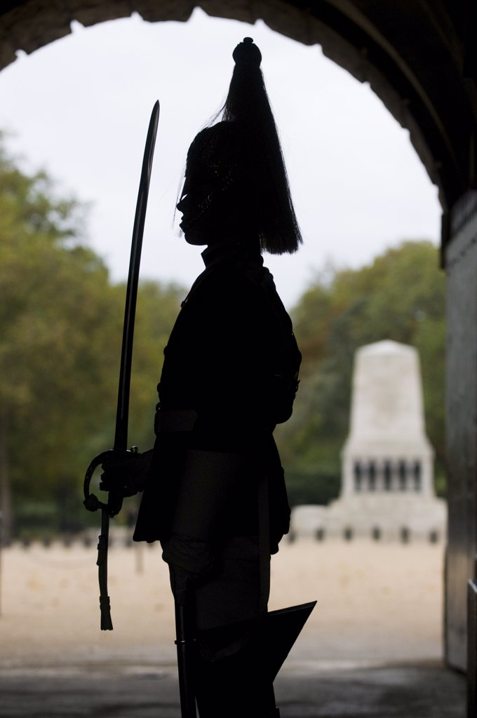 Stock Photo: 4282-14451 England, London, Whitehall. Silhouette of a soldier of the Household Cavalry on guard duty at Horse Guards in Whitehall.