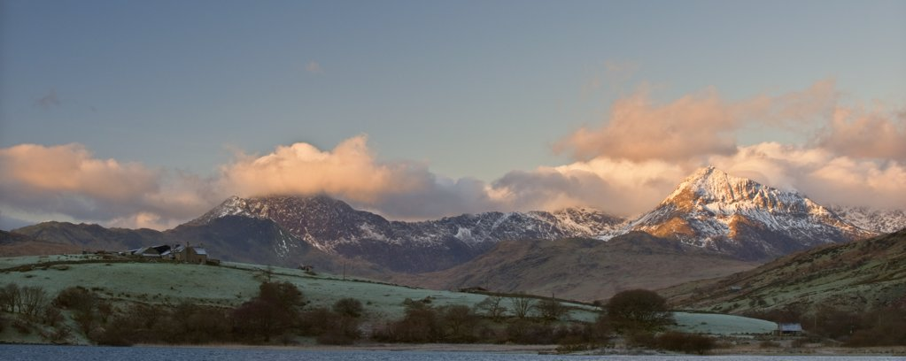 Stock Photo: 4282-14473 Wales, Clwyd, Capel Curig. A view of pink clouds surrounding the peak of Mount Snowdon from Capel Curig.