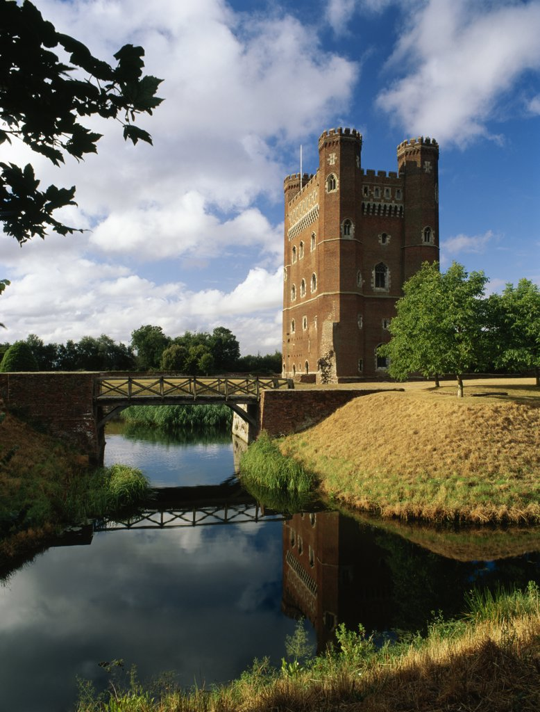 Stock Photo: 4282-14496 England, Lincolnshire, Tattershall. A view across the moat to the mid 15th century rectangular tower keep of Tattershall Castle, noted for its early use of brick.