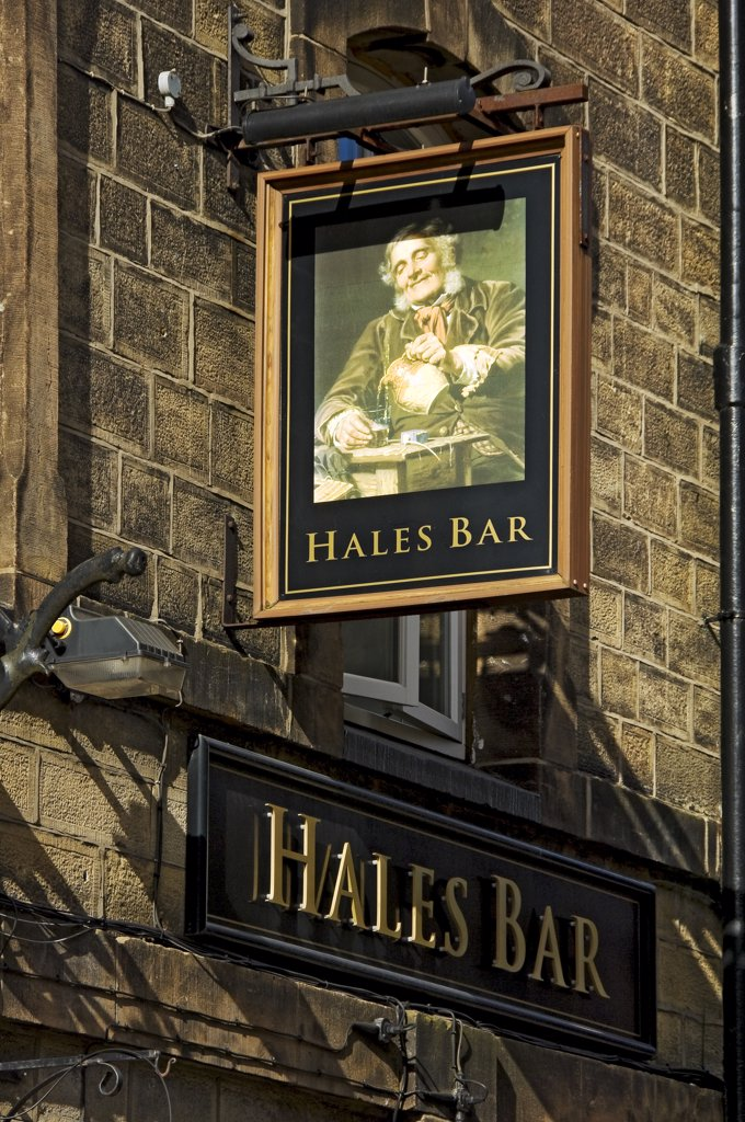 England, North Yorkshire, Harrogate. Hanging sign above the entrance to Hales Bar, Harrogate's only traditional gas-lit bar. : Stock Photo