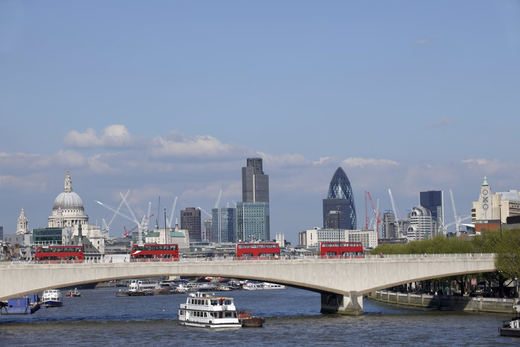 Stock Photo: 4282-1489 England, London, Embankment. London Bridge with red buses and the city skyline.