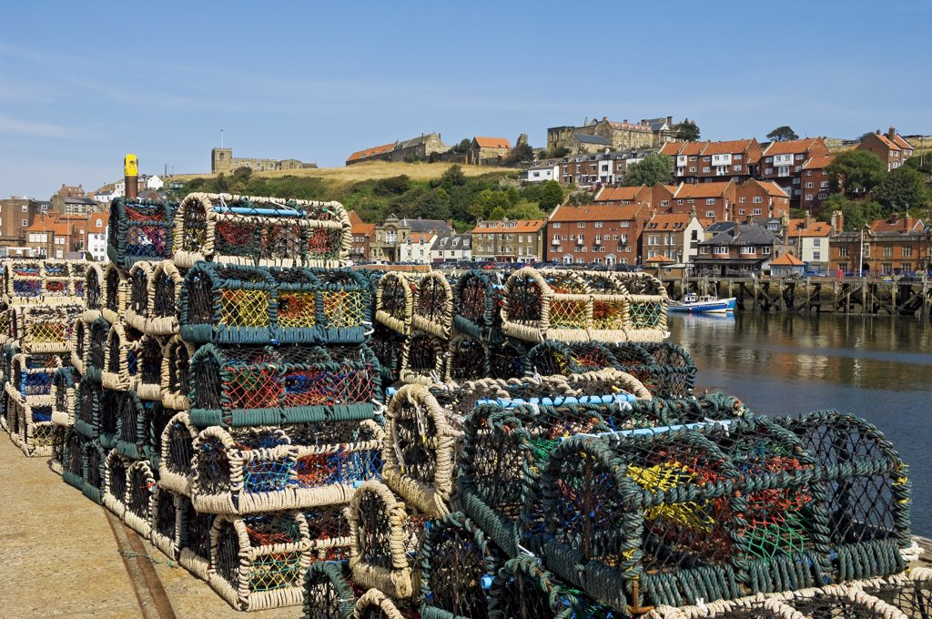 Stock Photo: 4282-15082 England, North Yorkshire, Whitby. Crab pots stacked on the quayside.