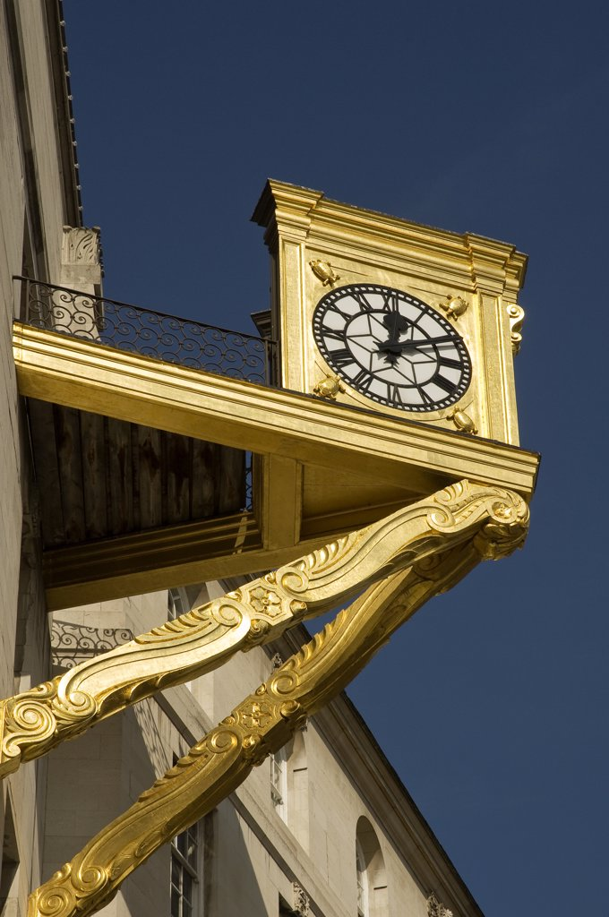 Stock Photo: 4282-15251 England, West Yorkshire, Leeds. Golden clock on Leeds Civic Hall in Millennium Square.