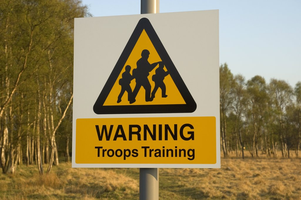 England, North Yorkshire, York. Troops Training warning sign on the common in York. : Stock Photo