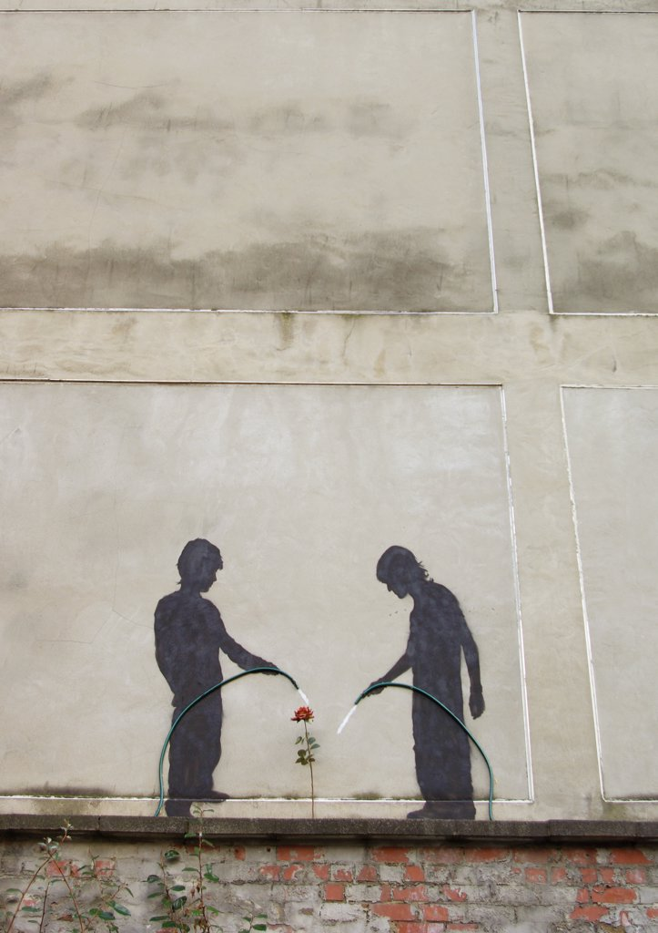 England, Tyne and Wear, Newcastle Upon Tyne. Urban art of two children watering a flower. : Stock Photo