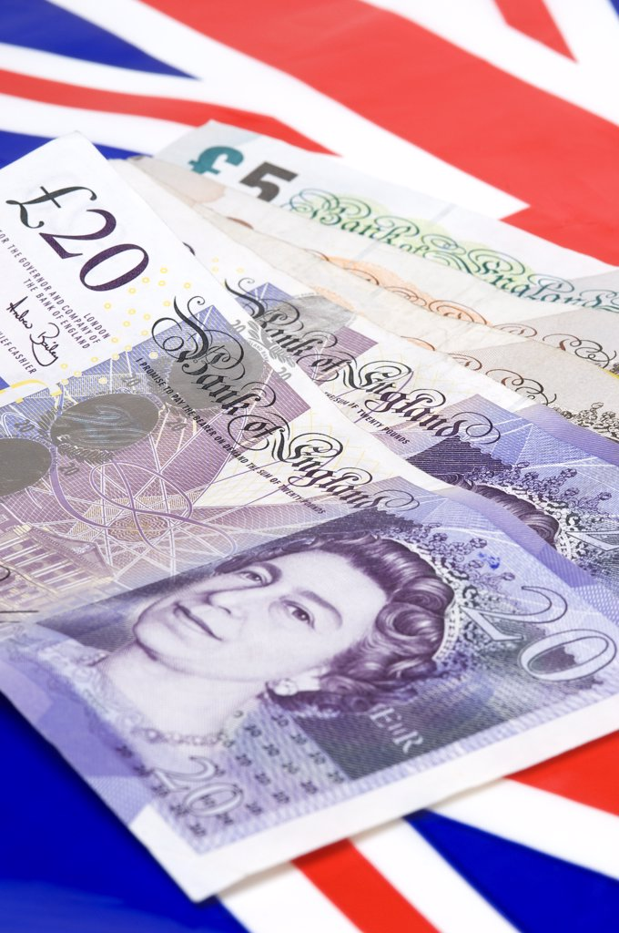 Stock Photo: 4282-15410 England. English currency with Union flag in the background.
