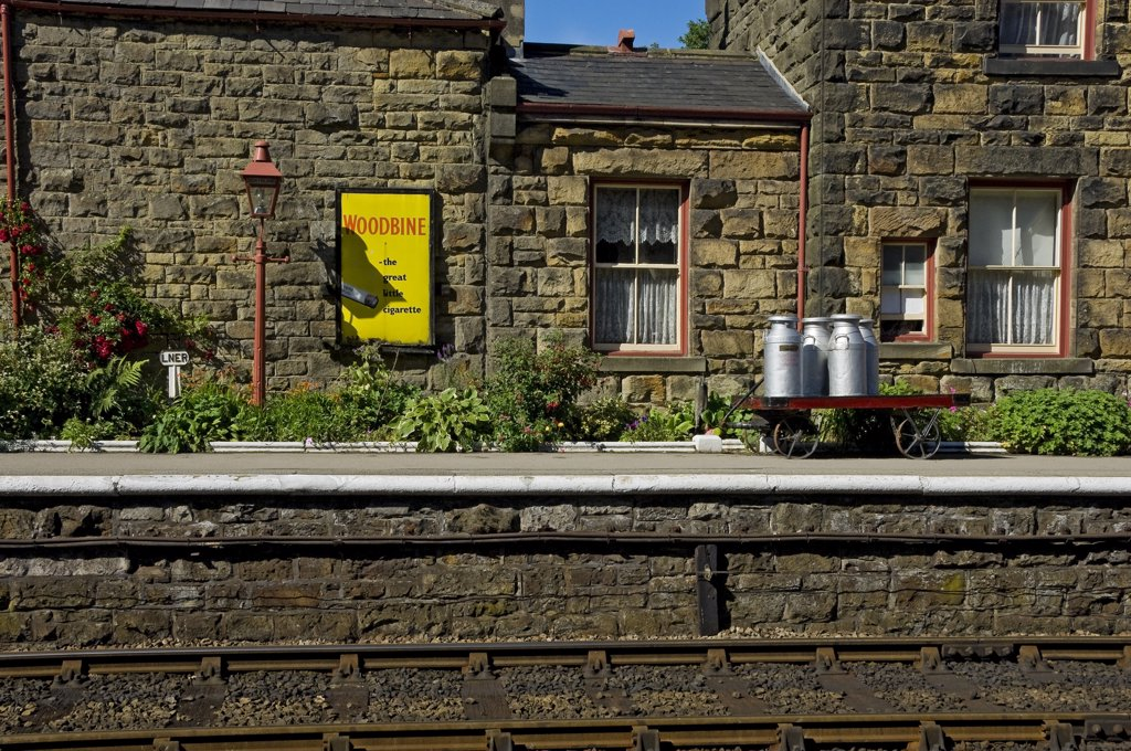 Stock Photo: 4282-15658 England, North Yorkshire, Goathland. An old advert for Woodbine cigarettes on the platform of Goathland railway station on the North Yorkshire Moors Railway.