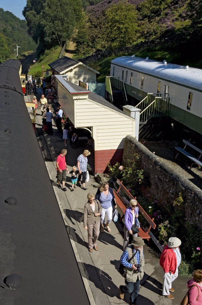 Stock Photo: 4282-15661 England, North Yorkshire, Goathland. Passengers disembarking from a train at Goathland railway station on the North Yorkshire Moors Railway.