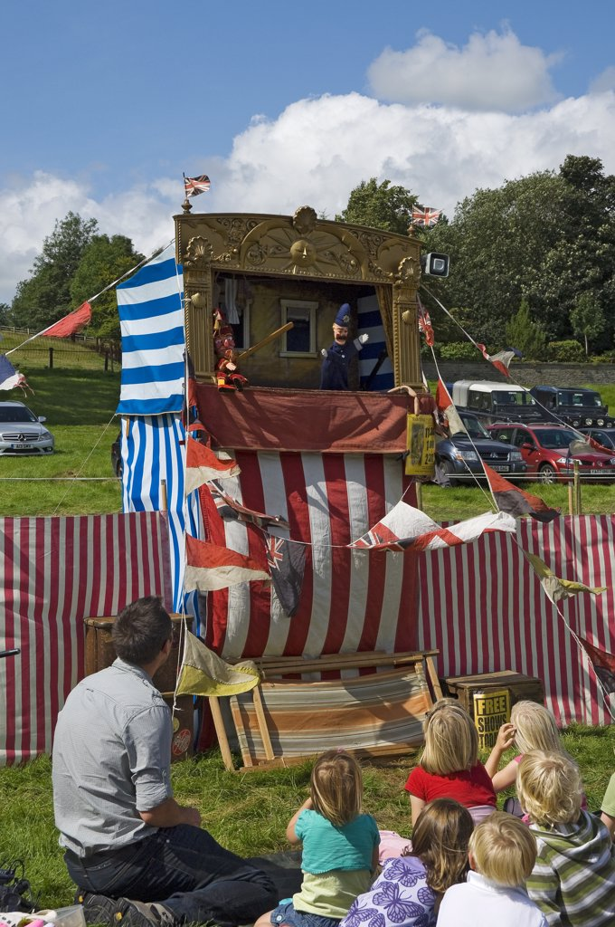 Stock Photo: 4282-15849 England, North Yorkshire, Gargrave. Young children enjoying a Punch and Judy at Gargrave Show, an annual country show near Skipton.