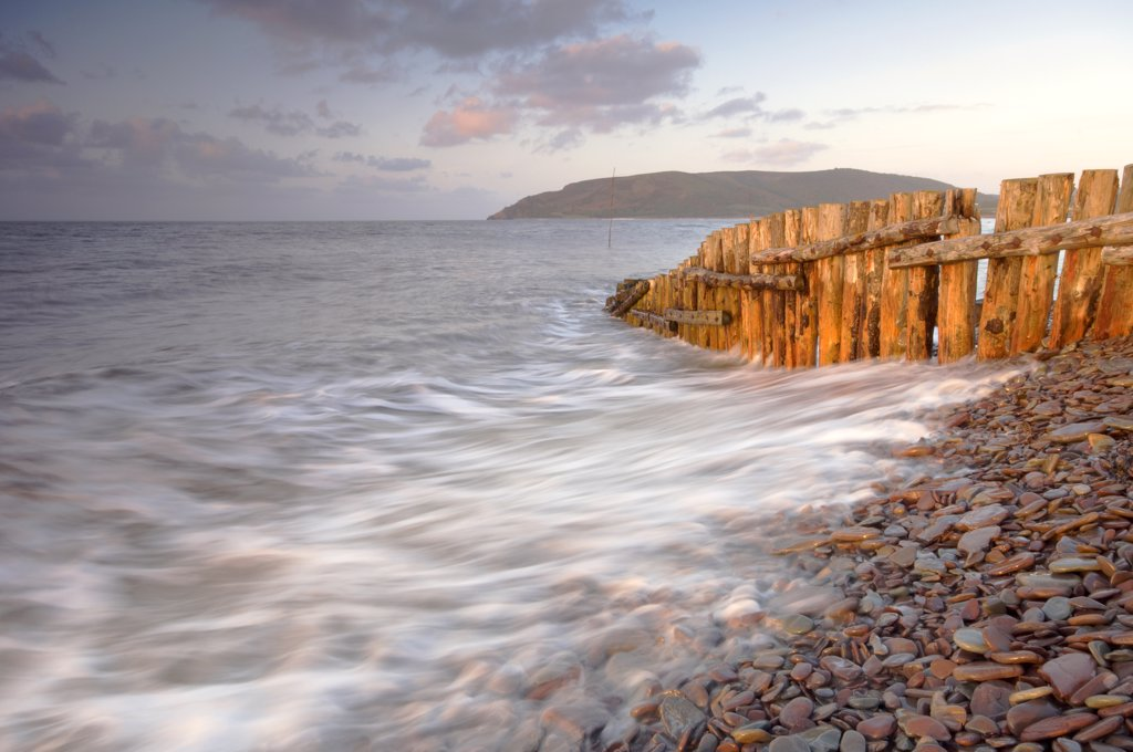 Stock Photo: 4282-16018 England, Somerset, Exmoor. Waves on the pebbly beach at Porlock Weir.