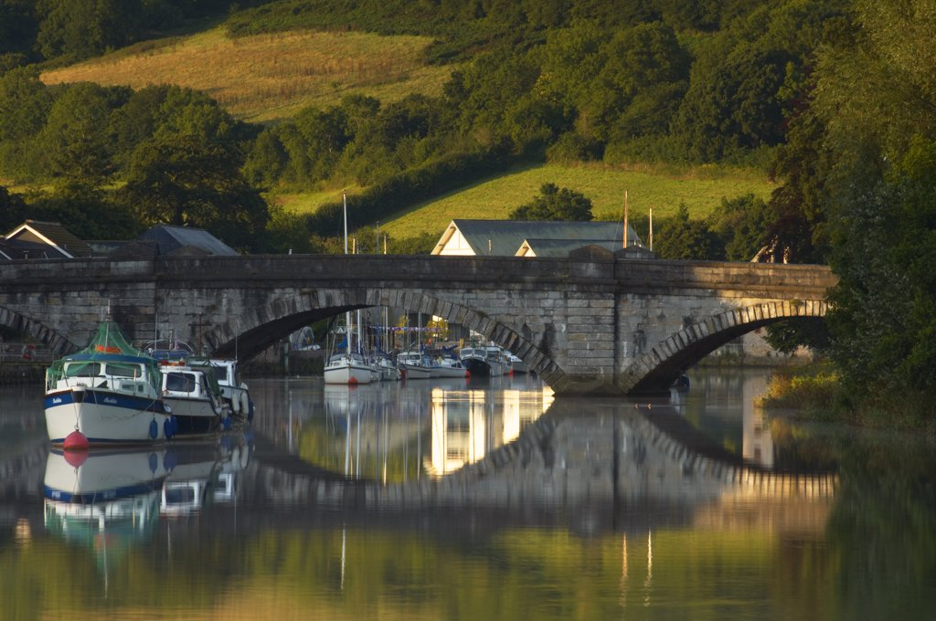 Stock Photo: 4282-16352 England, Devon, Totnes. Boats on the River Dart by Totnes Bridge at dawn.