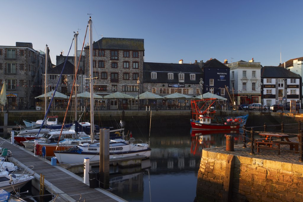 Stock Photo: 4282-16454 England, Devon, Plymouth. Fishing trawlers and yachts in the harbour at Plymouth's historic Barbican at dawn.
