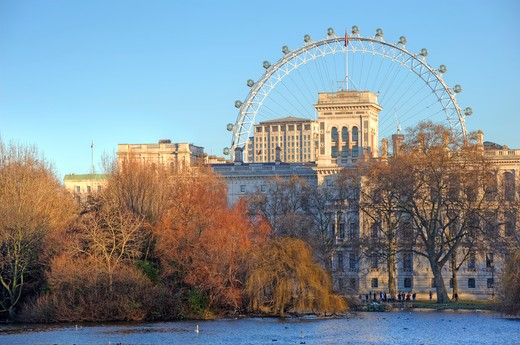 England, London, St James Park. View across a lake in St James Park towards Horseguards Parade and the London Eye. : Stock Photo