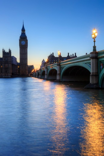 Stock Photo: 4282-16924 England, London, Westminster. Westminster Bridge spanning the River Thames towards Big Ben and the Houses of Parliament at sunset.