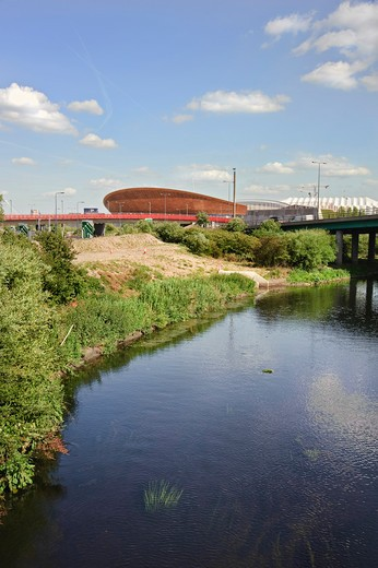 Stock Photo: 4282-17066 England, London, Stratford. The River Lea flowing alongside the Velodrome in Olympic Park, completed in February 2011 for the London 2012 Olympic and Paralympic Games.
