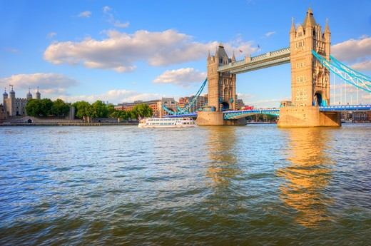 Stock Photo: 4282-17076 England, London, Tower Bridge. Tower Bridge, one of London's most iconic landmarks spanning the River Thames. The bridge was designed by Sir Horace Jones and Sir John Wolfe Barry and completed in 1894.