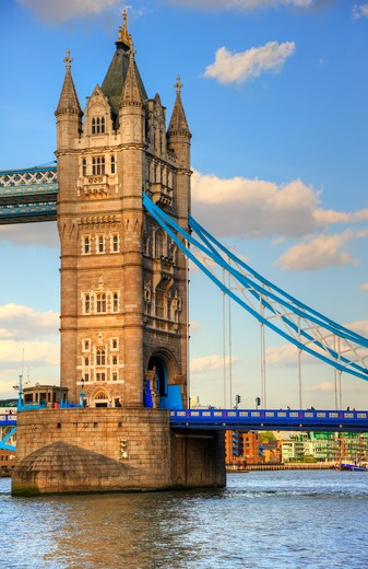 Stock Photo: 4282-17078 England, London, Tower Bridge. Tower Bridge, one of London's most iconic landmarks spanning the River Thames. The bridge was designed by Sir Horace Jones and Sir John Wolfe Barry and completed in 1894.